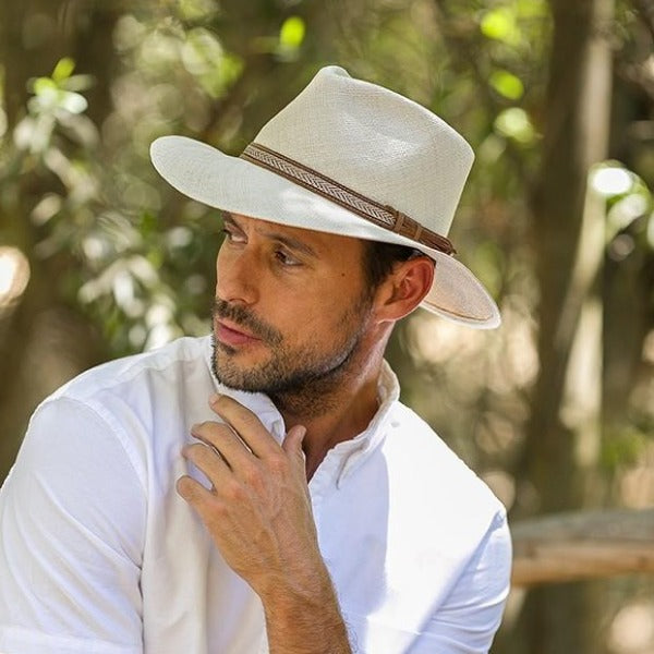 Man wearing beige straw panama hat with brown leather band
