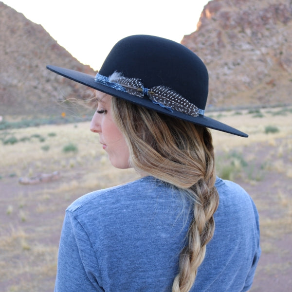 Open Crown black felt hat with feather