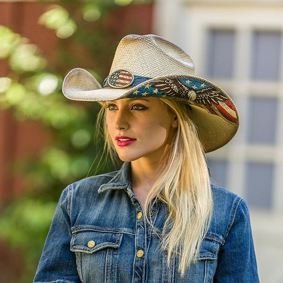 woman wearing american eagle cowboy hat