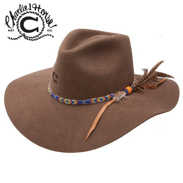 Brown tipped cowboy hat on white background with blue & orange band. Charlie 1 Horse brand.