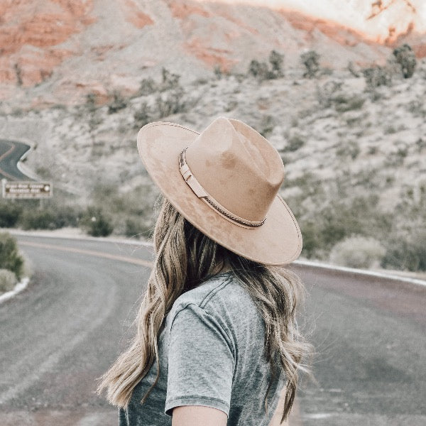 brown flat brim rancher hat