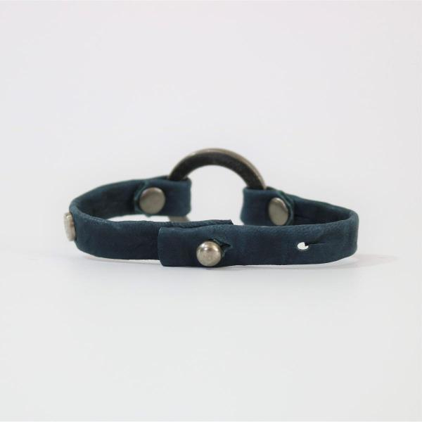 men's blue colored leather bracelet with silver cirlce hardware viewed from the backside with clasp