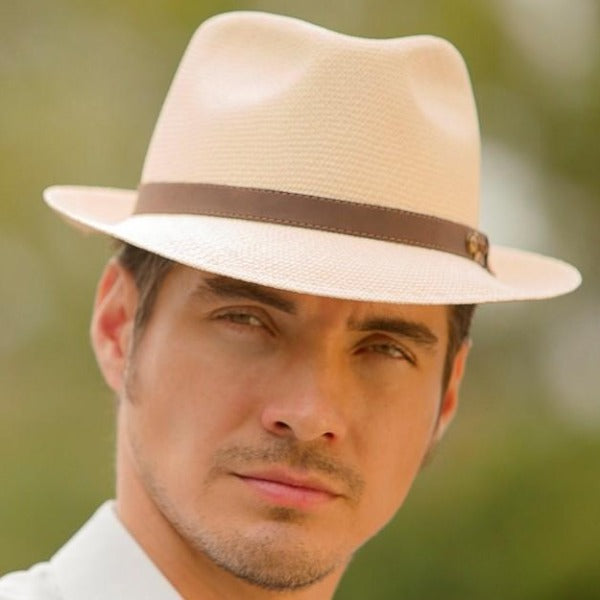 Man wearing beige fedora with brown leather band
