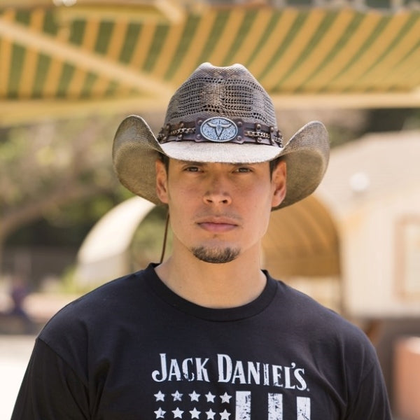 Man wearing Stampede Brown men's western hat with longhorn concho and chain band