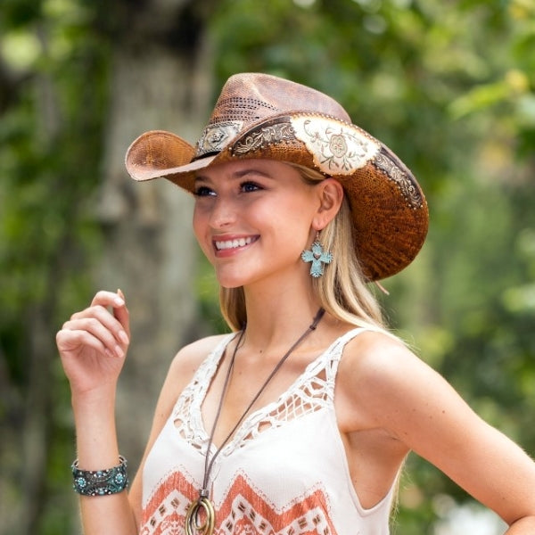 Woman Wearing Stampede womens brown straw hat with inlaid leather and flower pattern