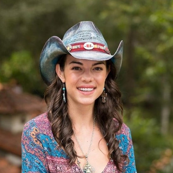Woman wearing Blue stained stampede straw hat with red sotuhwestern print band