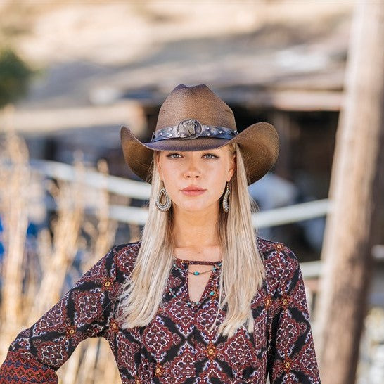 Blonde woman wearing brown Stampede cowboy hat with horse concho