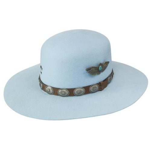 baby blue flat brim wool Charlie 1 Horse hat with brown leather band. the band has silver conchos. The open crown has a metal pinned bird on it.