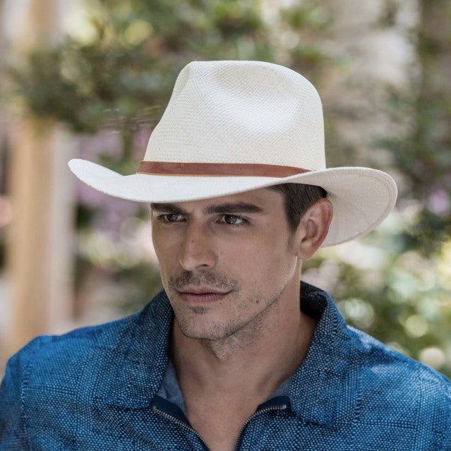 Man wearing white straw western hat