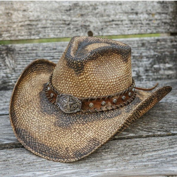 brown straw panama western cowboy stampede hat with star pendant and brown band on wooden bench