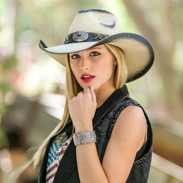 blonde women with black cut off jacket and american flag t-shirt wearing a tea stained genuine panama straw womens's stampede cowboy hat with cross pendant