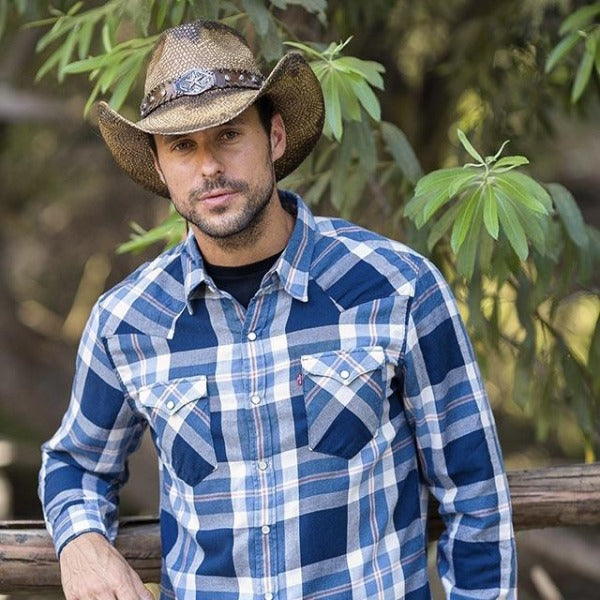 man wearing blue button up t-shirt and brown straw panama stampede cowboy hat