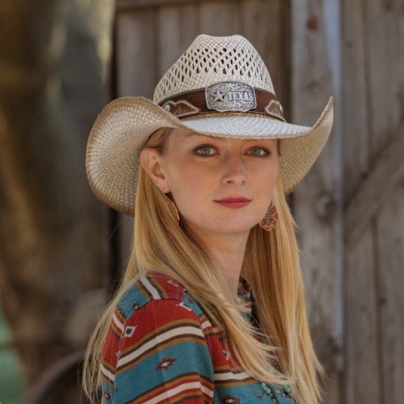 blonde woman wearing a southwest colors style long sleeve shirt with a stampede cowboy hat