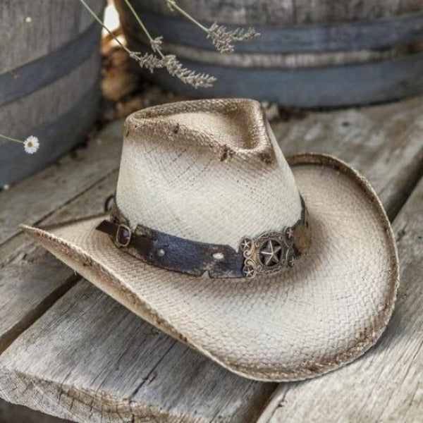 genuine panama straw western stampede cowboy hat with brown belt buckle band and five star pendant centerpiece on wooden table