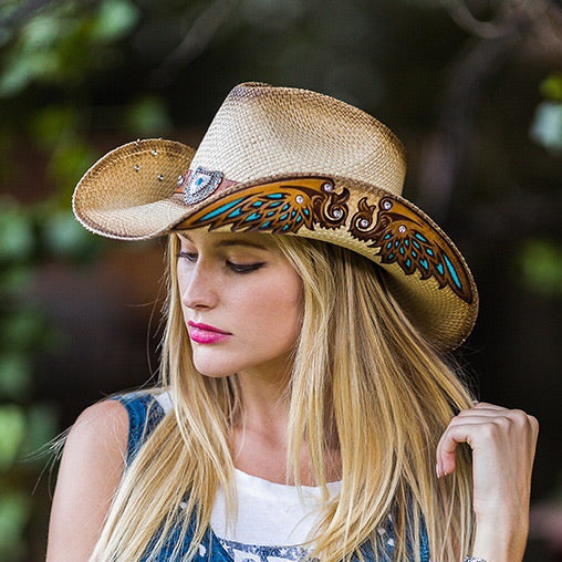 women in denim top wearing a tea stained colored cowboy hat with turquise inlaid leather