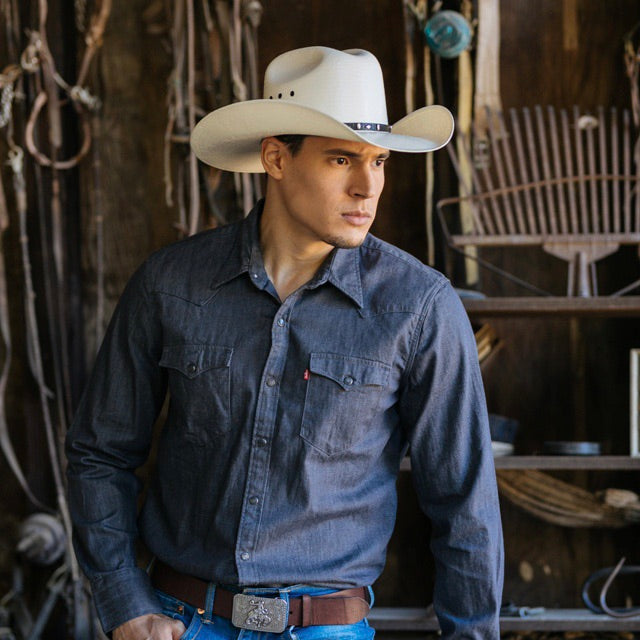 man wearing blue collared button up shirt with white bangora straw vented cowboy stampede hat with genuine black leather trim