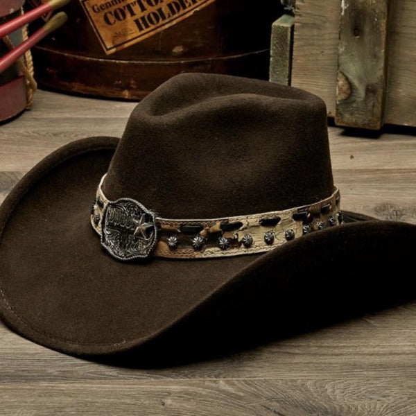 brown felt stampede cowboy hat with camo style beige belt and cowboy pendant on wooden table