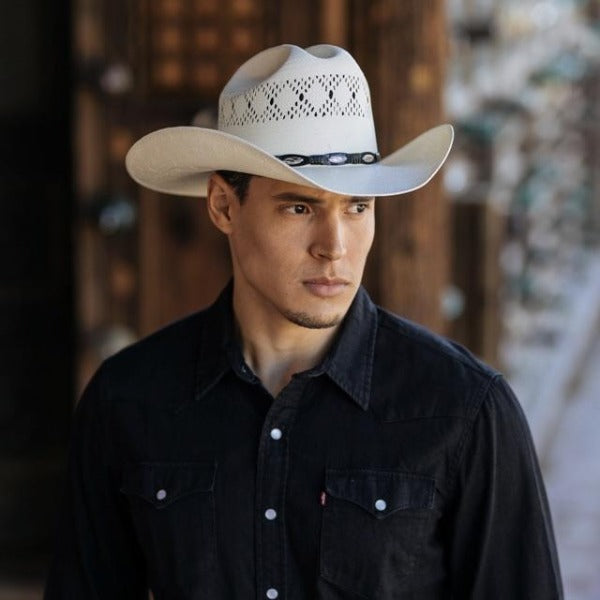 Man wearing black button up shirt with white bangora straw vented cowboy stampede hat with genuine black leather trim