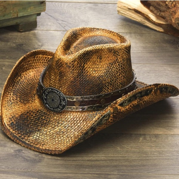 black and brown genuine panama straw stampede cowboys hat with gun cylinder pendant on wooden floor