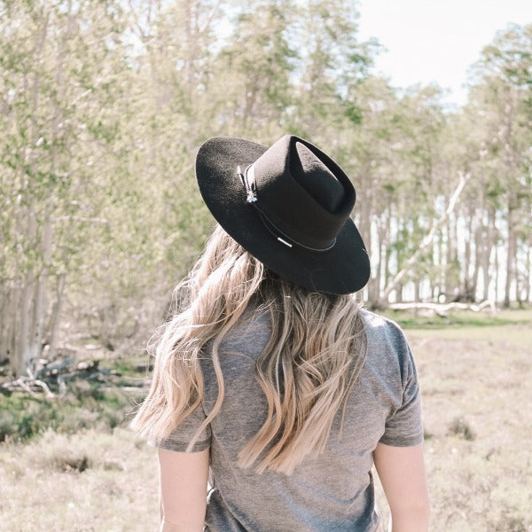 woman wearing black stetson rancher hat the Dylan