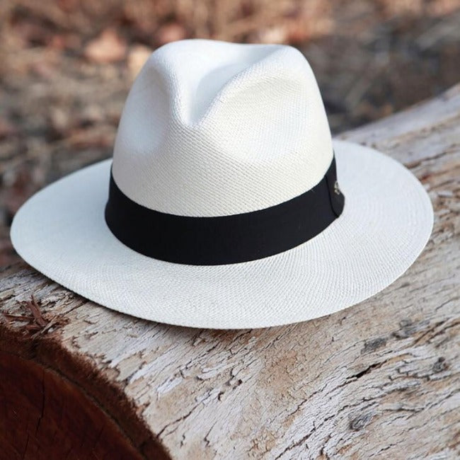 White panama straw hat with black ribbon