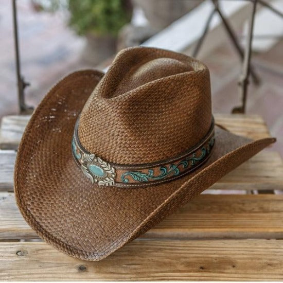 brown straw cowboy western stampede panama hat with turquoise pendant on wooden bench