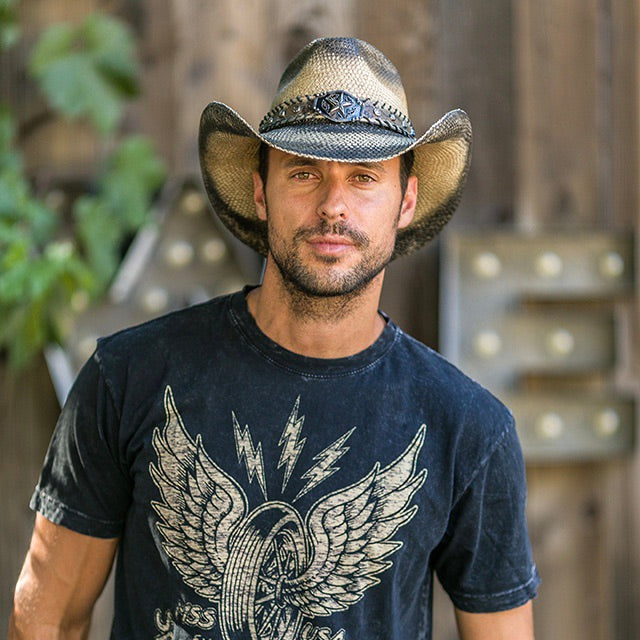 Man in dark navy blue t-shirt with wheel and wings design wearing black stained genuine panama straw western stampede cowboy hat