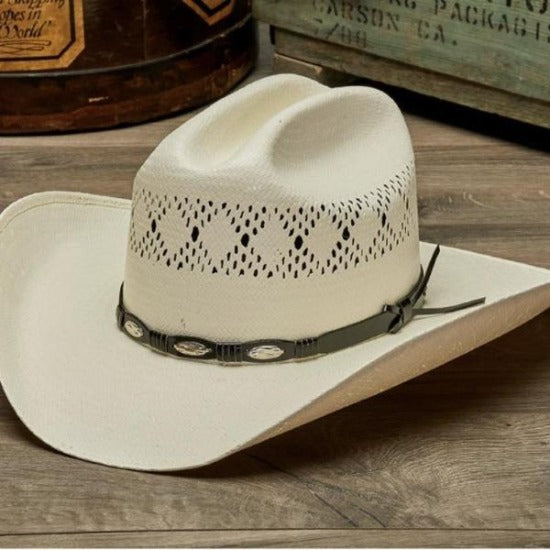 white bangora straw vented cowboy stampede hat with genuine black leather trim on wooden table