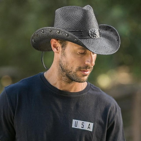 man with black usa t-shirt wearing black cowboy stampede hat and star pendant