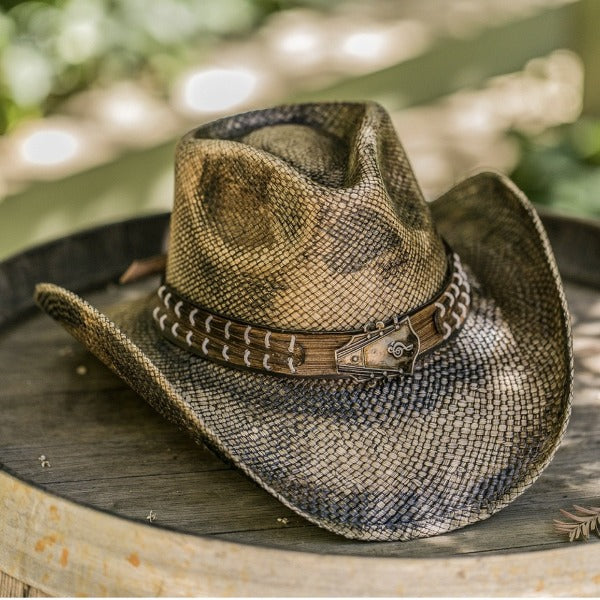 snake skin patterned cowboy western stampede hat and guitar head pendant on top of barrel