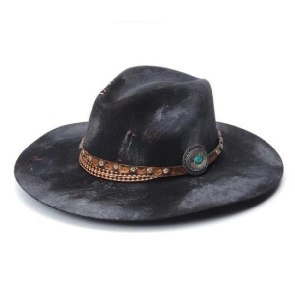 distressed stampede brand flat brim hat. Black felt hat with embellished leather hat band, and a turquoise concho.