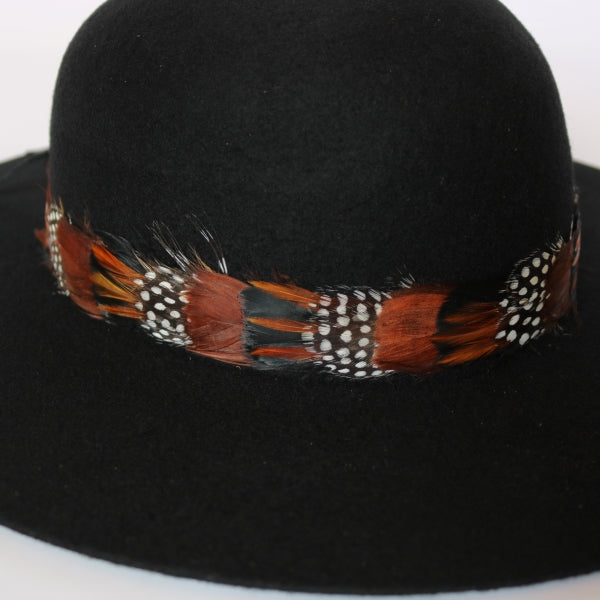 remove-able feather hat band with brown, black, and spotted feathers