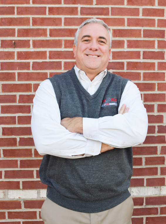 Jerry Jehn against brick wall at Waltz Business Solutions in Kentucky