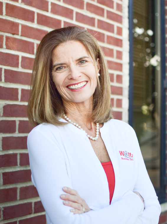 Kathy Jehn against brick wall at Waltz Business Solutions in Kentucky