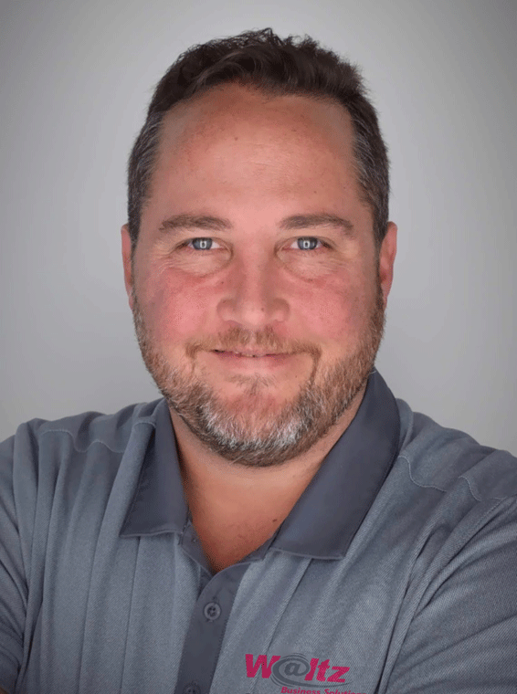 Mike Roenker against a grey background at Waltz Business Solutions in Kentucky