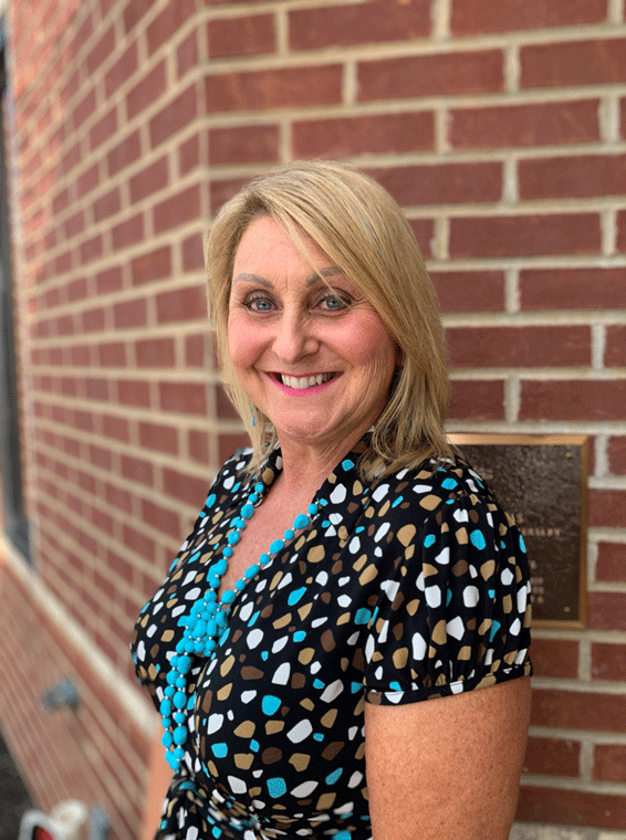 Mindy Welch against brick wall at Waltz Business Solutions in Kentucky