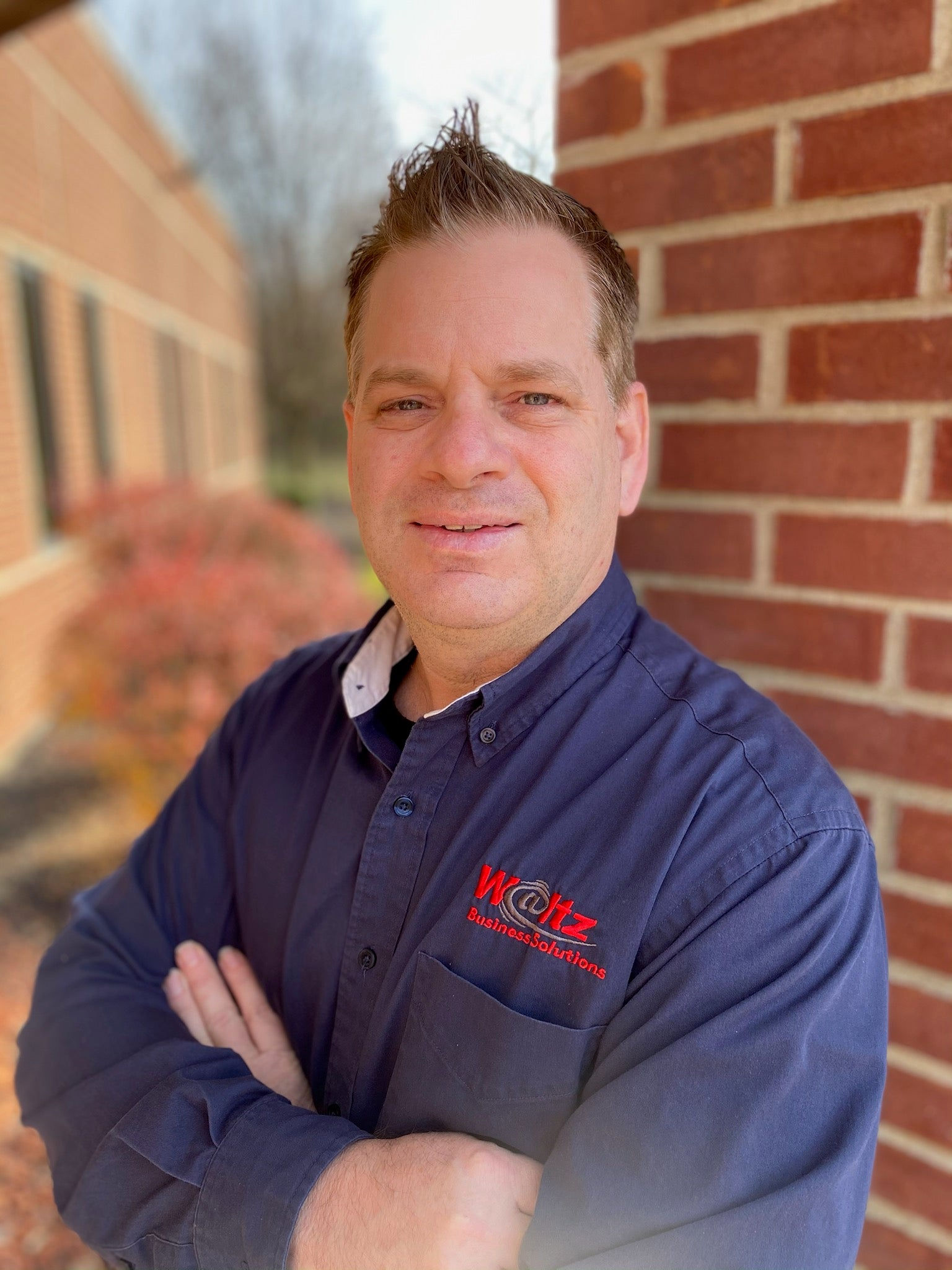 Grant Whitely against brick wall at Waltz Business Solutions in Kentucky