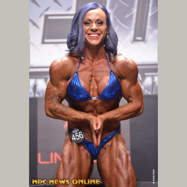 IFBB Pro Brittany in her bodybuilding suit.