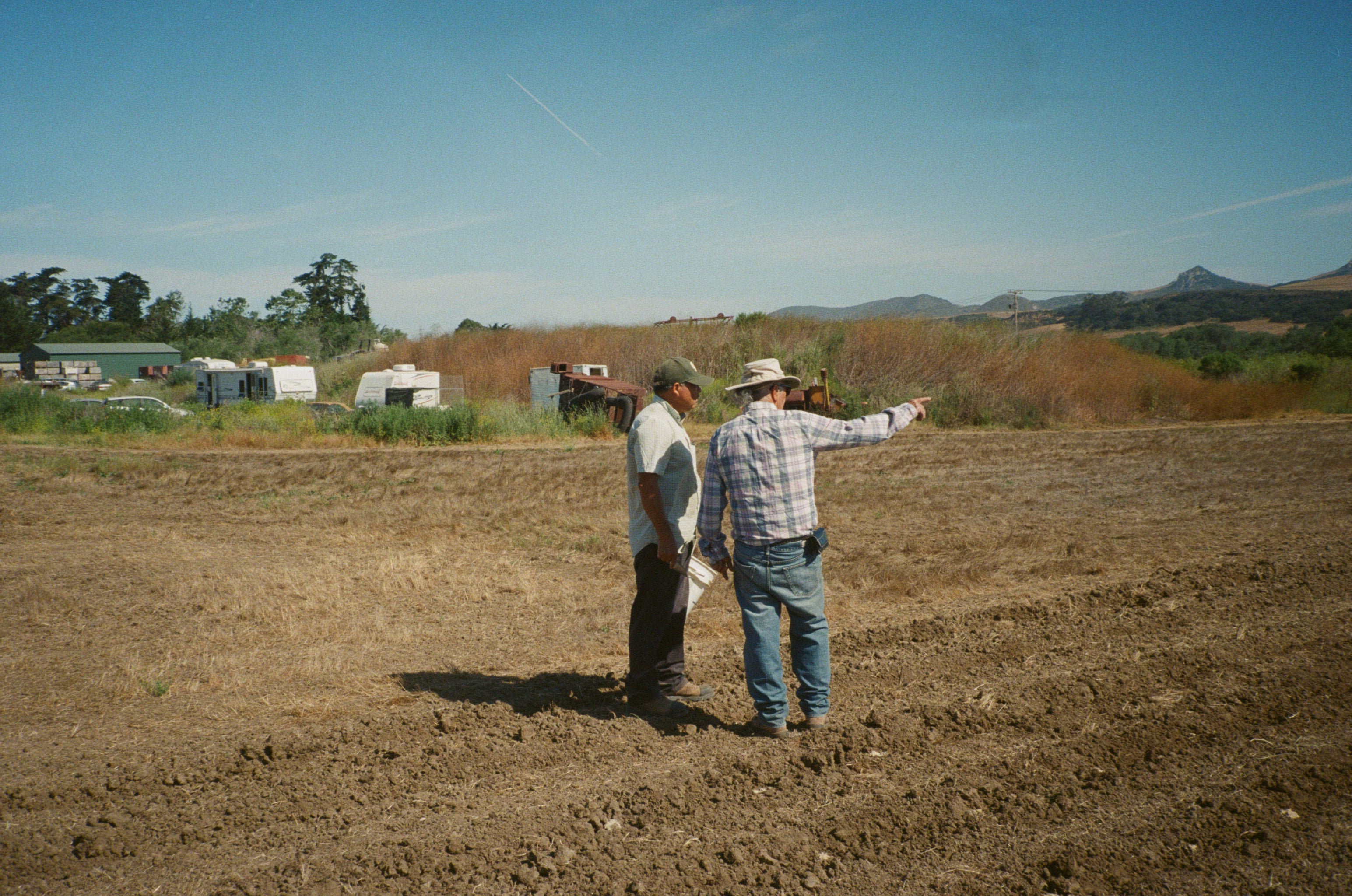 Farmers' on the field discussing plans for planting