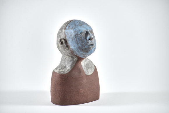 Title: Little Blue Artist: Sally Fitchard Medium: clay sculpture Size: 17.8 cm x 9.7 cm x 6.5 cm (front view, right side). Colours comprise- light blue, terracotta, light grey