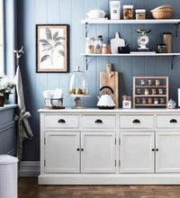 Load image into Gallery viewer, A deep blue kitchen with white cabinetry and shelving. displayed are kitchen wares along with a pantry rack sitting on the counter top. This image is from Home Beautiful Magazine .