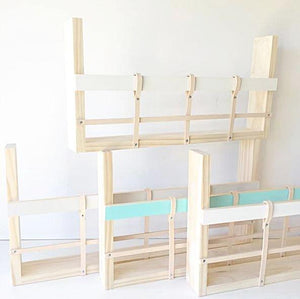 Four timber and leather book racks displaying three colour options, white, grey and turquoise.