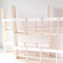 Load image into Gallery viewer, Four timber and leather book racks stacked on top of each other. They are empty to show the structure of the design and they are white in colour.