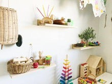 Load image into Gallery viewer, A child's bedroom wall a trio of shelves holding wooden toys, baskets and colourful objects.