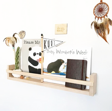 Load image into Gallery viewer, Tasmanian Oak timber book shelf in raw pine against a white all. Displayed are children's books and toys. A brown dream catcher hangs on the wall.