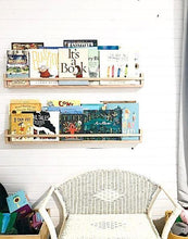 Load image into Gallery viewer, two timber bookshelves hang above a white vintage cane chair. The shelves are filled with childrens books.