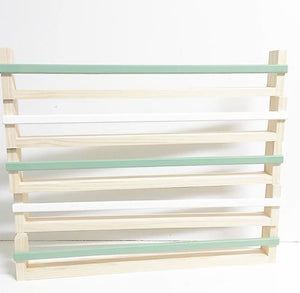 five bookshelves stacked on top of each other to display the product. Colours shown are white and moss