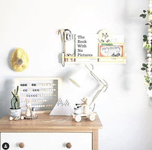 Load image into Gallery viewer, a timber dresser in a crisp white childs room with toys sitting on it and bookshelves on the wall above.
