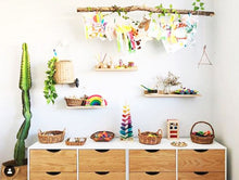 Load image into Gallery viewer, A colourful scene showing a childs bedroom with a timber cabinet, wooden toys and a trio of shelves sits above, holding more wooden toys, baskets and sensory play objects.