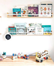 Load image into Gallery viewer, 2 timber book shelves on a white wall, filled with children's books. They sit above a timber cabinet with wooden toys displayed